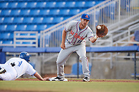 St. Lucie Mets first baseman Patrick Mazeika (11) stretches for a throw as Andrew Guillotte (1) dives back to first during a game against the Dunedin Blue Jays on April 19, 2017 at Florida Auto Exchange Stadium in Dunedin, Florida.  Dunedin defeated St. Lucie 9-1.  (Mike Janes/Four Seam Images)