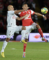 BOGOTÁ -COLOMBIA, 04-05-2014. Francisco Meza (Der) de Independiente Santa Fe disputa el balón con Edwards Jimenez (Izq) del Once Caldas durante partido de vuelta por los cuartos de final de la Liga Postobón  I 2014 jugado en el estadio Nemesio Camacho el Campín de la ciudad de Bogotá./ Independiente Santa Fe player Francisco Meza (R) fights for the ball with Once Caldas player Edwards Jimenez (L) during second leg match for the quarterfinals of the Postobon League I 2014 played at Nemesio Camacho El Campin stadium in Bogotá city. Photo: VizzorImage/ Gabriel Aponte / Staff