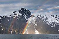 Rainbow arcs over Mt Curtis, Barry arm and the Chugach mountains, Prince William Sound, southcentral, Alaska.