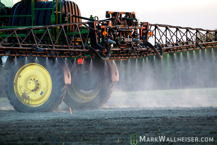 Randy Dowdy and his girlfriend Patsy Davis sprays herbicide near Valdosta, Ga. March 31, 2014.