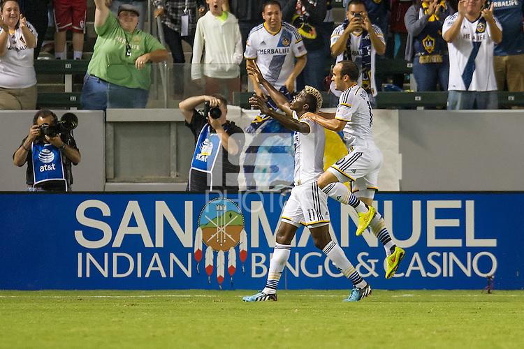 CARSON, CA - August 8, 2014: LA Galaxy players Gyasi Zardes (11) and Landon Donovan (10) celebrate Zardes' goal during the LA Galaxy vs San Jose Earthquakes match at the StubHub Center in Carson, California. Final score, LA Galaxy 2, San Jose Earthquakes 2.