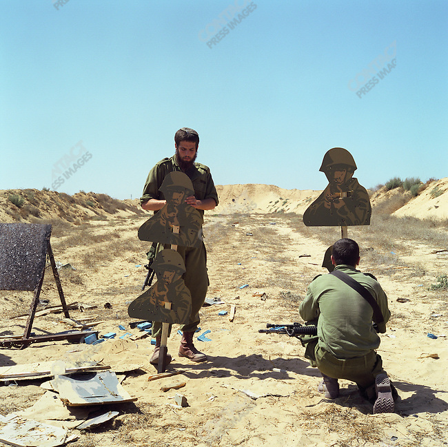IDF soldiers stationed in the Netzarim settlement, target practice at a rifle range in Gaza, July 2005.