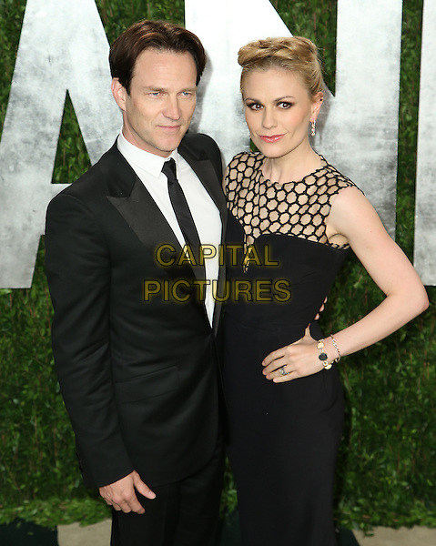 Stephen Moyer & Anna Paquin.2013 Vanity Fair Oscar Party following the 85th Academy Awards held at the Sunset Tower Hotel, West Hollywood, California, USA..February 24th, 2013.oscars half length black suit sleeveless dress hand on hip netting married husband wife .CAP/ADM/SLP/DOW.©Dowling/StarlitePics/AdMedia/Capital Pictures