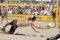Huntington Beach, CA - 5/6/07:  Jake Gibb  dives for the ball during Gibb / Rosenthal's 21-17, 21-18 loss to Lambert / Metzger in the championship match of the AVP Cuervo Gold Crown Huntington Beach Open of the 2007 AVP Crocs Tour..Photo by Carlos Delgado