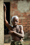 A boy stands outside his home near Kasese in rural Southwestern Uganda.