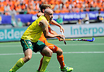 The Hague, Netherlands, June 15: Glenn Turner #4 of Australia and Jeroen Hertzberger #11 of The Netherlands in action during the field hockey gold match (Men) between Australia and The Netherlands on June 15, 2014 during the World Cup 2014 at Kyocera Stadium in The Hague, Netherlands. Final score 6-1 (2-1)  (Photo by Dirk Markgraf / www.265-images.com) *** Local caption ***