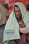 A Rohingya man, having just crossed the border from Myanmar, waits to complete registration in the Kutupalong Refugee Camp near Cox's Bazar, Bangladesh. <br /> <br /> More than 600,000 Rohingya have fled government-sanctioned violence in Myanmar for safety in Bangladesh.