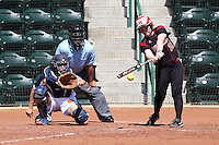 Rutgers batter Kylee Bishop #21 bats in front of Netherlands catcher Nathalie Timmermans #26 and umpire Al Staniford during a game against Rutgers at the USF Bulls Softball Complex on March 14, 2012 in Tampa, Florida.  (Mike Janes/Four Seam Images)