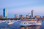 Boats gather on the Charles River at dusk before the July 4th celebration in Boston, Massachusetts, USA