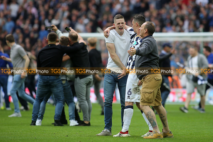 Millwall fans celebrate on the pitch at the end of the match during Bradford City vs Millwall, Sky Bet EFL League 1 Play-Off Final at Wembley Stadium on 20th May 2017