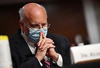 CDC Director Dr. Robert Redfield pauses during testimony before the Senate Health, Education, Labor and Pensions (HELP) Committee, during a hearing on Capitol Hill in Washington DC on Tuesday, June 30, 2020. Government health officials updated the Senate on how to safely get back to school and the workplace during the COVID-19 pandemic.<br /> Credit: Kevin Dietsch / Pool via CNP /MediaPunch