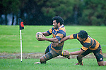 Alepini Olosono slides over past Bobby Motuliki to score Patumahoe's first try. Counties Manukau Premier Club Rugby game between Patumahoe and Bombay played at the Patumahoe Domain on Saturday June 4th 2011 as part of the Patumahoe 125th Anniversary celebrations. Patumahoe won 24 - 3 after leading 5 - 3 at halftime.