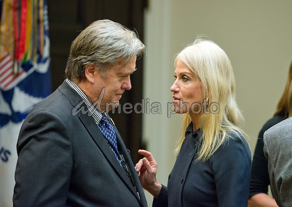 Assistant to the President and Chief Strategist Steve Bannon, left and Counselor to the President Kellyanne Conway, right, have a conversation prior to the arrival of US President Donald Trump who will hold a listening session with cyber security experts in the in the Roosevelt Room of the White House in Washington, DC on Tuesday, January 31, 2017. Photo Credit: Ron Sachs/CNP/AdMedia