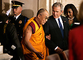 U.S. President George W. Bush escorts the Dalai Lama into the Capitol rotunda where he will be honored with a Congressional Gold Medal in Washington DC USA on 17 October 2007.