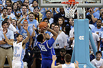 07 March 2015: Duke's Jahlil Okafor (15) gets behind North Carolina's Marcus Paige (5) and takes a shot. The University of North Carolina Tar Heels played the Duke University Blue Devils in an NCAA Division I Men's basketball game at the Dean E. Smith Center in Chapel Hill, North Carolina. Duke won the game 84-77.