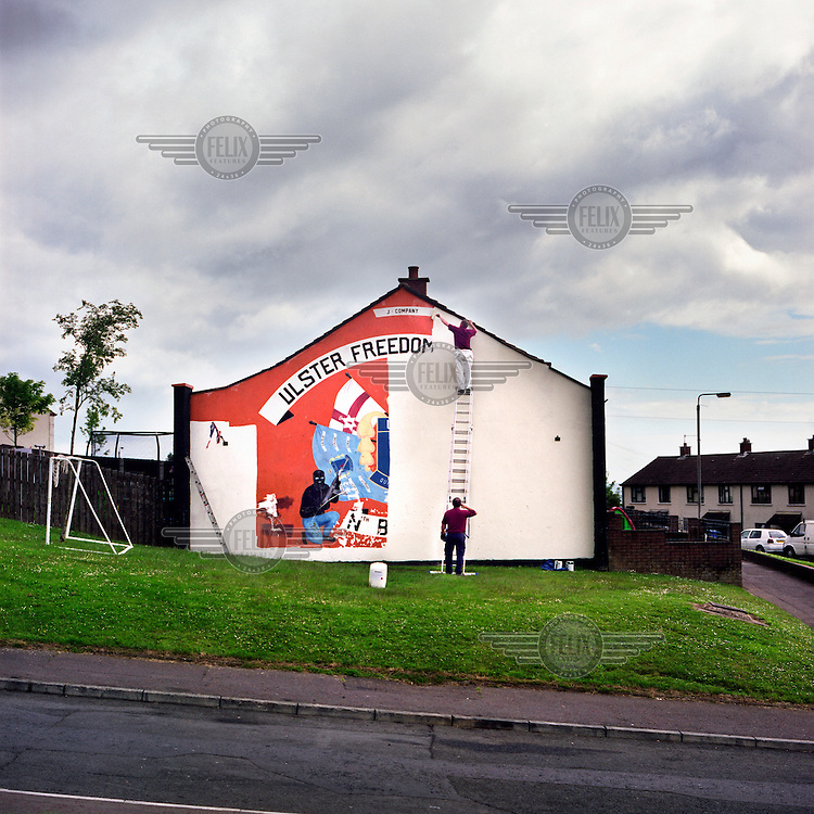 Workmen paint over the last loyalist UDA (Ulster Defence Association) paramilitary mural in North Belfast. In an attempt to modernise and in alliance with the progression of other cross-community initiatives, the organisation has committed to replacing traditional murals with those encorporating a more community friendly ethos.