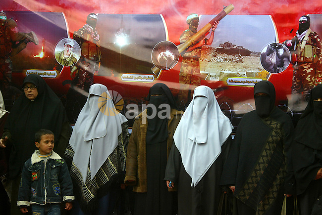 Palestinian women attend an exhibition organized by Hamas marks the second anniversary of Israel's three-week offensive on Gaza, in the southern Gaza Strip town of Rafah on December 29, 2010. Which more than a thousand Palestinians were killed in the Israel's war between the late 2008 and early 2009. Photo by Abed Rahim Khatib