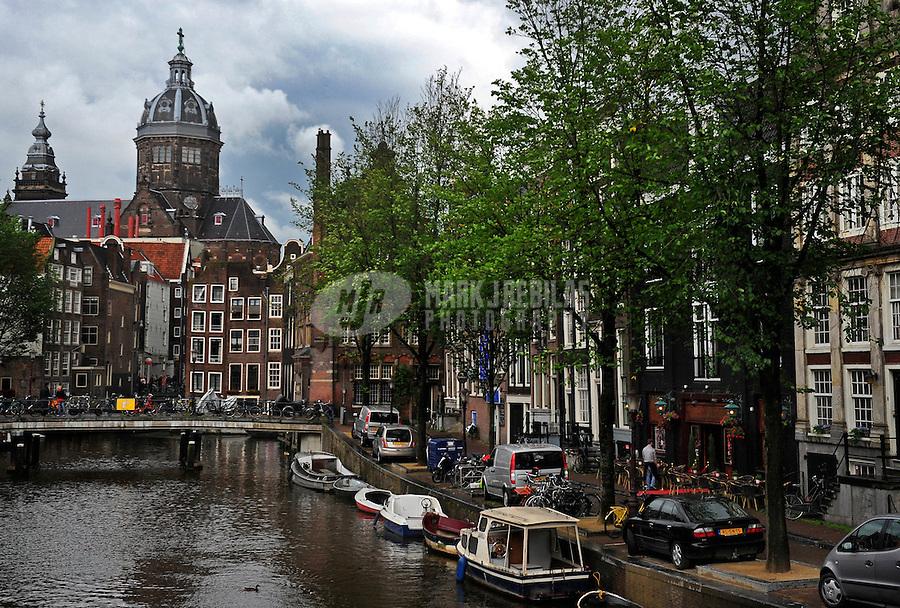 Amsterdam Holland Netherlands apartment water reflection europe city lights urban condo canal boathouse church steeple urban dusk