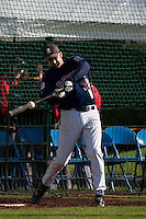 10 october 2009: Ian Young makes contact while batting practice during game 3 of the 2009 French Elite Finals won 4-2 by Savigny over Rouen, at Stade Jean Moulin stadium in Savigny sur Orge, near Paris, France.