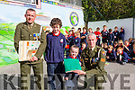 Defence Forces members Sergeant Chris Hoare, Killorglin originally and Gunner James Power, Waterford, presents the   tricolour and Proclamation to the youngest and Oldest pupils  l-r Jack O'Hare and Eve Donoghue of Listellick NS to commemorate the 100 year anniversary on Monday