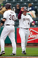 Brent Seifert (4) of the Missouri State Bears high fives Luke Voit (30) after scoring during a game against the Oral Roberts Golden Eagles on March 27, 2011 at Hammons Field in Springfield, Missouri.  Photo By David Welker/Four Seam Images