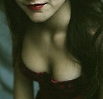 Close up of a young woman wearing a basque