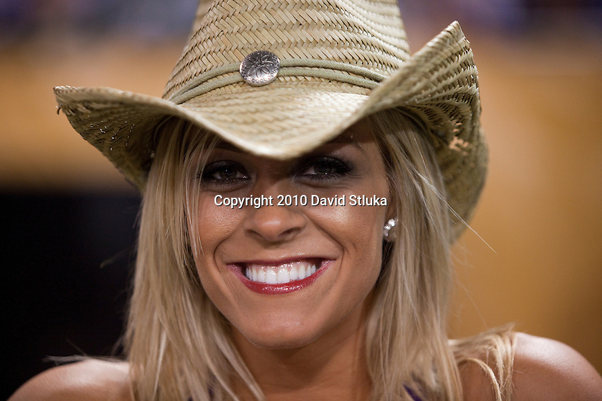 A Minnesota Vikings cheerleader smiles during an NFL football game against the Green Bay Packers in Minneapolis, Minnesota on November 21, 2010. The Packers won 31-3. (AP Photo/David Stluka)