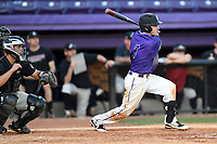 Shortstop Brett Huebner (3) of the Furman Paladins bats in game two of a doubleheader against the Harvard Crimson on Friday, March 16, 2018, at Latham Baseball Stadium on the Furman University campus in Greenville, South Carolina. The catcher is Devan Peterson. Furman won, 7-6. (Tom Priddy/Four Seam Images)