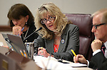 From left, Nevada Assembly Republicans Robin Titus and Jill Dickman and Sen. David Parks, D-Las Vegas, work in committee at the Legislative Building in Carson City, Nev., on Tuesday, May 5, 2015.   <br /> Photo by Cathleen Allison