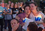 Lucy Karam (left) is hugged by her twin sister Anna Capistrant as they watch balloons float away after a balloon release and candlelight vigil that was held at Heartland Park in Wentzville, MO on Wednesday September 19, 2018 in memory of two year-old Felicity Karam, who died after being hit by an ice cream truck on Sunday. At left is Andy Karam, Felicity's father.