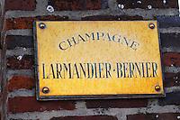 A polished brass sign saying Champagne Larmandier Bernier, Champagne Larmandier-Bernier, Vertus, Cote des Blancs, Champagne, Marne, Ardennes, France