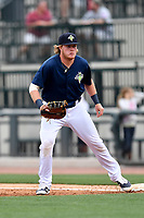 First baseman Dash Winningham (34) of the Columbia Fireflies plays defense in a game against the Lexington Legends on Sunday, April 23, 2017, at Spirit Communications Park in Columbia, South Carolina. Lexington won, 4-2. (Tom Priddy/Four Seam Images)
