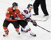 Patrick Geering (Switzerland - 4), Raimonds Vilkoits (Latvia - 7) - Team Switzerland defeated Team Latvia 7-5 on Wednesday, December 30, 2009, at the Credit Union Centre in Saskatoon, Saskatchewan, during the 2010 World Juniors tournament.