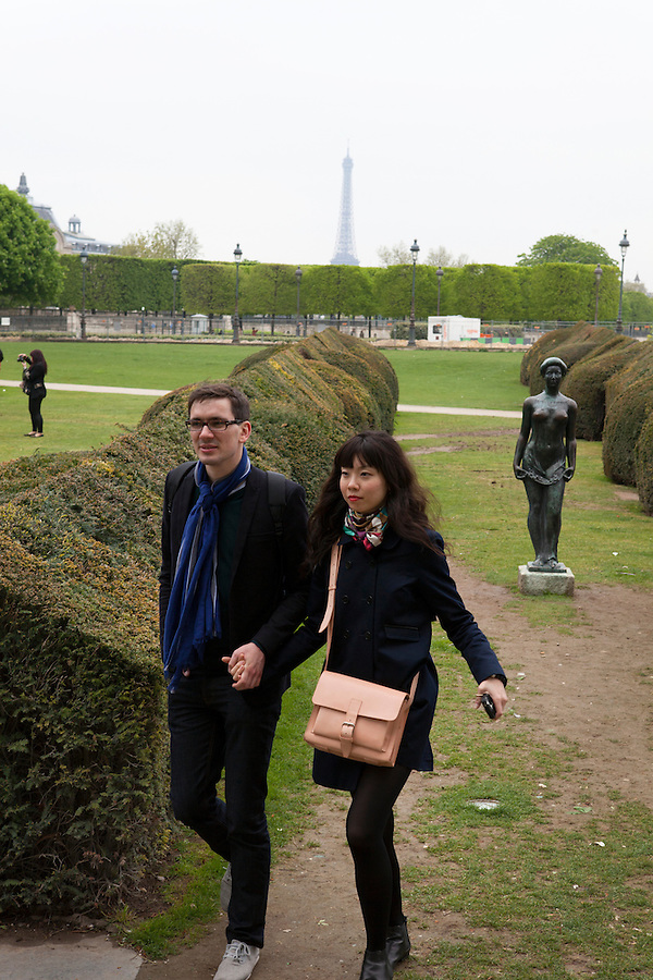 "A couple walks by ""Flora,"" a statue by ARISTIDE MAILLOL, (1911), Tuileries Gardens (Jardin des Tuileries) in spring, Paris, France, Europe"