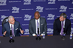 High Point University President Dr. Nido Qubein (left) answers questions during a press conference as new men's basketball head coach Tubby Smith (center) and Athletic Director Dan Hauser (right) look on at the Hayworth Fine Arts Center on the campus of High Point University on March 27, 2018 in High Point, North Carolina.  (Brian Westerholt/Sports On Film)