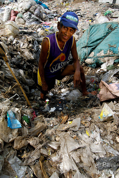A recycler in a garbage dump in Quezon City, Philippines. The Philippine NGO KKFI supports a child care program here in the Ariano Masa Mission Center of the Puno United Methodist Church.