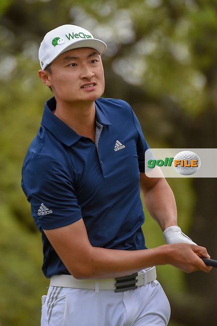 HaoTong Li (CHN) watches his tee shot on 12 during day 2 of the WGC Dell Match Play, at the Austin Country Club, Austin, Texas, USA. 3/28/2019.<br /> Picture: Golffile | Ken Murray<br /> <br /> <br /> All photo usage must carry mandatory copyright credit (© Golffile | Ken Murray)