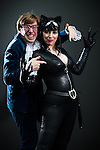 © Joel Goodman - 07973 332324 . 26/07/2015 . Manchester , UK . Portrait : AUSTIN POWERS & CAT WOMAN ( husband and wife Chris Stone , 31 , and Stephanie Stone , 29 , both from Stoke-on-Trent ) at the venue . Comic Con convention at Manchester Central Convention Centre . Photo credit : Joel Goodman