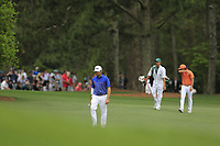 Louis Oosthuizen (RSA) and Rickie Fowler (USA) making there way onto the 18th green during the final round at the The Masters , Augusta National, Augusta, Georgia, USA. 14/04/2019.<br /> Picture Fran Caffrey / Golffile.ie<br /> <br /> All photo usage must carry mandatory copyright credit (© Golffile | Fran Caffrey)
