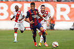 Rayo Vallecano´s  and Barcelona´s Neymar Jr (L) during La Liga match between Rayo Vallecano and Barcelona at Vallecas stadium in Madrid, Spain. October 04, 2014. (ALTERPHOTOS/Victor Blanco)