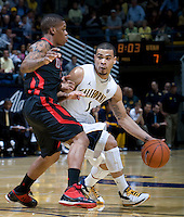 Justin Cobbs of California controls the ball away from Utah defender during the game against Utah at Haas Pavilion in Berkeley, California on January 14th, 2012.  California defeated Utah, 81-45.