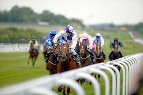 May 26, 2004: CHRIS CATLIN rides ELISHA (purple/white cap) to victory in the Goodwood Flying School Maiden Auction Stakes at Goodwood Photo: Steve Bardens/Action Plus...horse racing 040526 flat