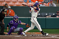 Right fielder Seth Beer (28) of the Clemson Tigers bats in a game against the Furman Paladins on Tuesday, February 20, 2018, at Doug Kingsmore Stadium in Clemson, South Carolina. The catcher is Logan Taplett; the umpire is Darion Padgett. Clemson won, 12-4. (Tom Priddy/Four Seam Images)