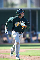 Dusty Coleman #7 of the Oakland Athletics runs to first base during a Minor League Spring Training Game against the Los Angeles Angels at the Los Angeles Angels Spring Training Complex on March 17, 2014 in Tempe, Arizona. (Larry Goren/Four Seam Images)