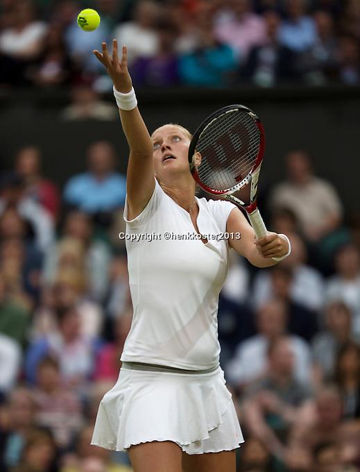 02-07-13, England, London,  AELTC, Wimbledon, Tennis, Wimbledon 2013, Day eight, Petra Kvitova (CZE) serving<br /> <br /> <br /> <br /> Photo: Henk Koster