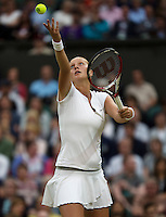 02-07-13, England, London,  AELTC, Wimbledon, Tennis, Wimbledon 2013, Day eight, Petra Kvitova (CZE) serving<br /> <br /> <br /> <br /> Photo: Henk Koster
