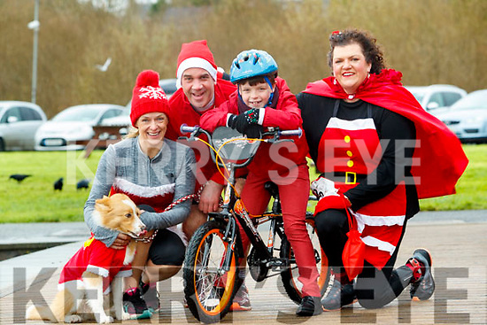 Morna O'Halloran, Eoin Porter, Joe O'Halloran and Louise Porter and (Goldie the Dog), who took part in the Santa Run at Tralee Bay Wetlands on Sunday morning last.