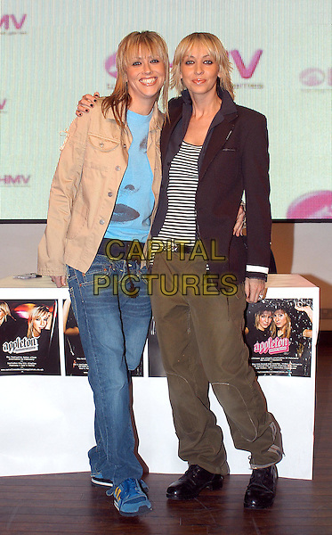 "APPLETON - NICOLE APPLETON & NATALIE APPLETON.attend signing of their new album ""Everything's Eventual"" at HMV Music Store.denim jeans, military, blazer, stripes, rock chick, mullet.www.capitalpictures.com.sales@capitalpictures.com.© Capital Pictures."
