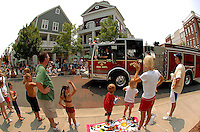 Kids and families watch the annual Fourth of July Celebration and community parade in Birkdale Village in Huntersville, NC. Birkdale Village combines the best of shopping, dining, apartments and entertainment venues within a 52-acre mixed-use development.