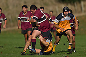 Mika Pamaka tries to fight his way out of the Te Kauwhata tacklers. CMRFU Counties Power Cup Game of the Week between Te Kauwhata & Puni played at Te Kauwhata on Saturday May the 3rd, 2008..Te Kauwhata led 5 - 0 at halftime & went on to win 29 - 0.